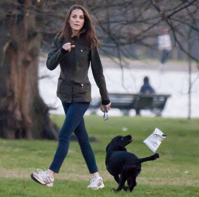 Duchess of Cambridge takes Lupo for a walk in Kensington Park Gardens.