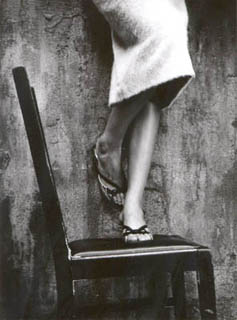 woman_standing_on_chair