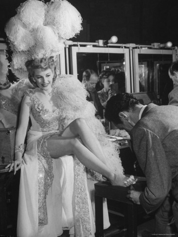 john-florea-chorus-girl-getting-a-pedicure-during-filming-of-the-movie-the-ziegfeld-follies
