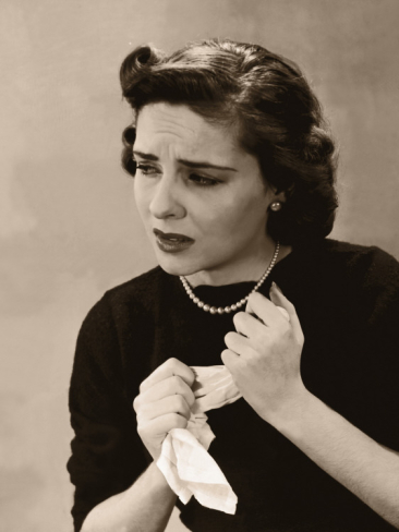 anxious-nervous-woman-wringing-handkerchief-in-her-hands_i-G-56-5655-PMSMG00Z